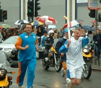 jonathan edwards and the olympic torch in wandsworth 26 june 2004