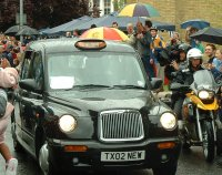 the olympic torch left wandsworth in a black cab